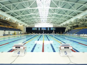 commonwealth games swimming pool striped tiles white blue image no people photograph photography long smart well organised colour team gb apex