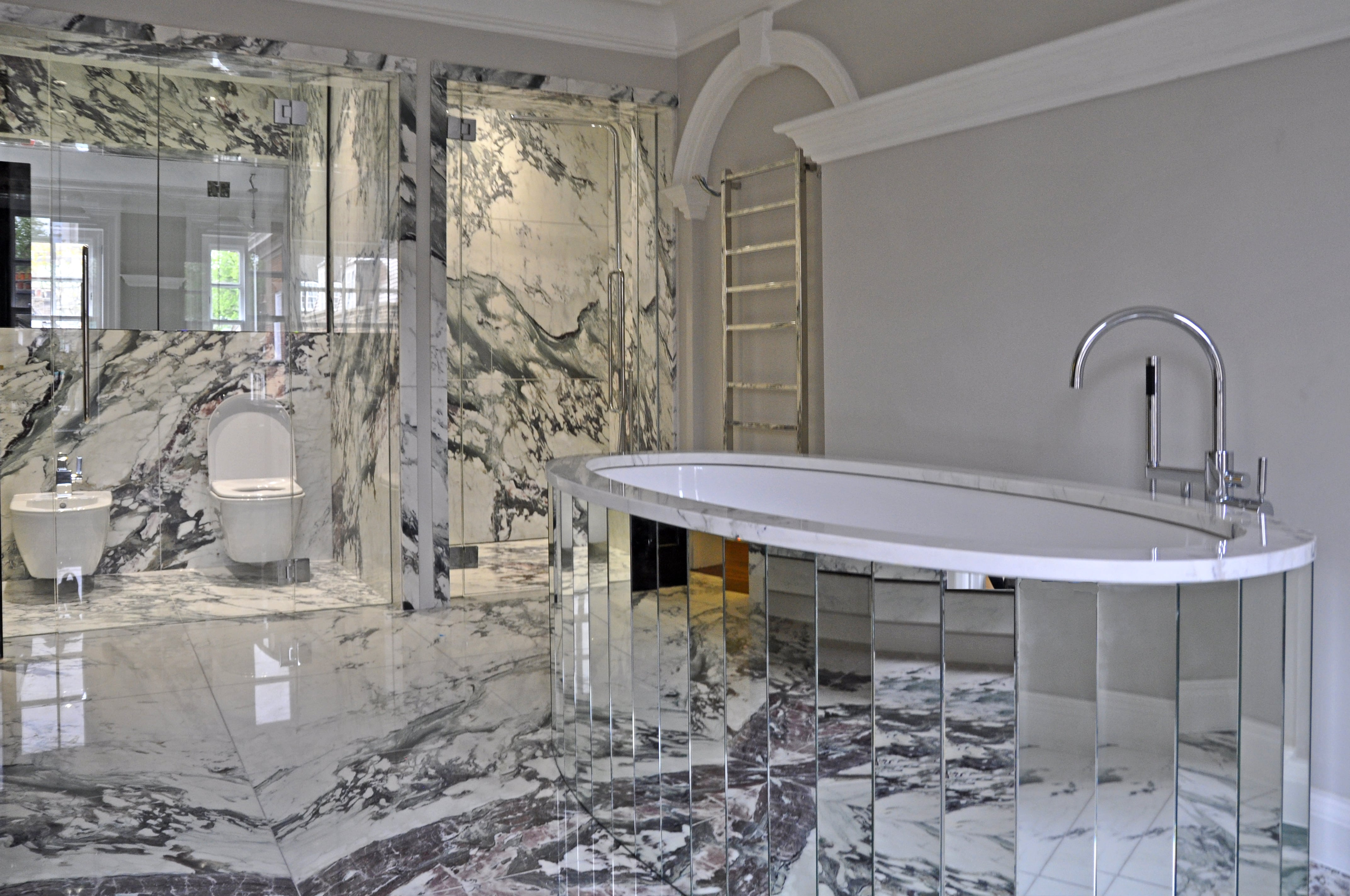 white marble tiles modern bathroom mirrored tile bathtub image no people photograph photography long smart well organised colour wealth
