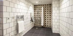 indigo bathroom white shiny tiles square pattern criss cross star pattern image no people photograph photography long smart well organised colour
